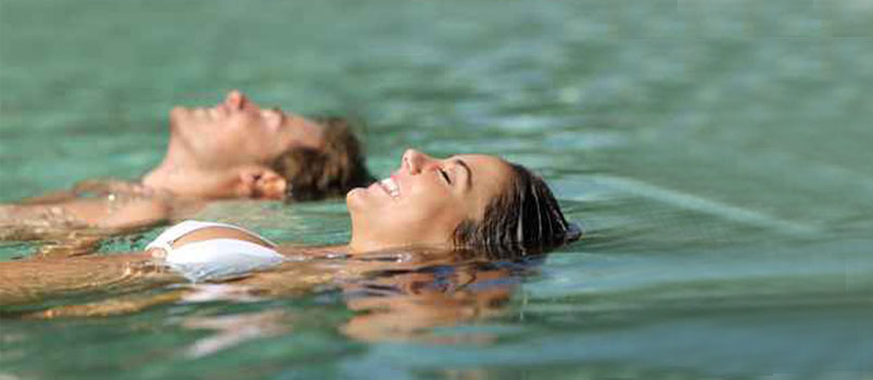 Couple doing swimming together