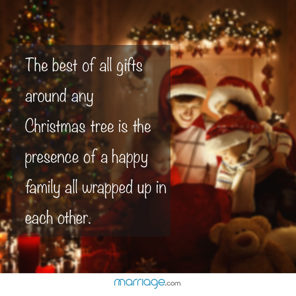 The best of all gifts around any Christmas tree is the presence of a happy family all wrapped up in each other.