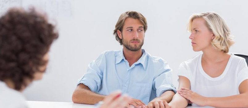 Man And Women Meeting Therapist In His Office