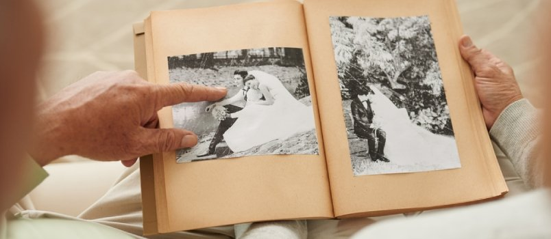 Finger pointed at black and white pictures of married couple