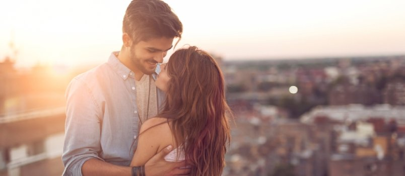 Man and woman in love with each other as they look in each other's eyes