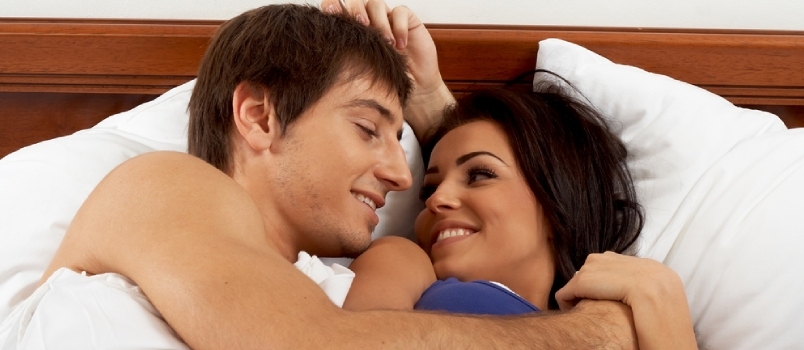 Attractive Couple In Love Having Intimate At Bedroom