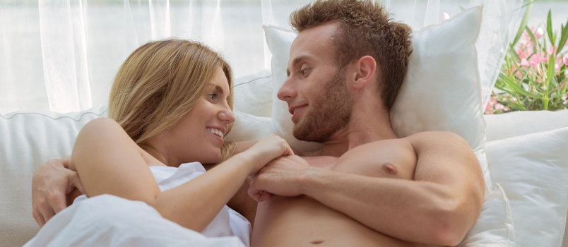 Horizontal View Of Romantic Couple In Bedroom