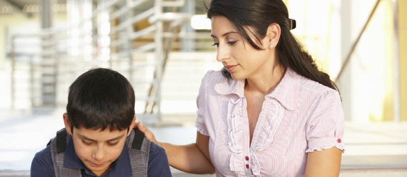 Unhappy Pre Teen Boy In School Mother Trying To Convince