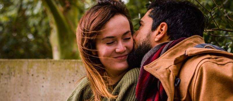 Man Kissing A Beautiful Woman Outdoor