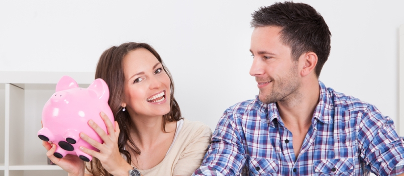 Man And Women Are Happy To Save Money In Piggybank
