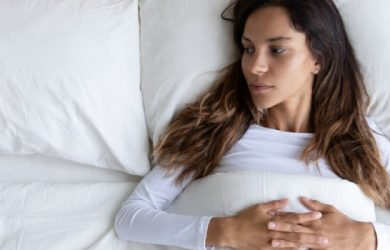 Pensive Young Woman Lying Alone In Cozy White Bed Thinking Or Pondering Over Relationships Problem