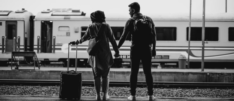 Couple On Platform At The Train Station