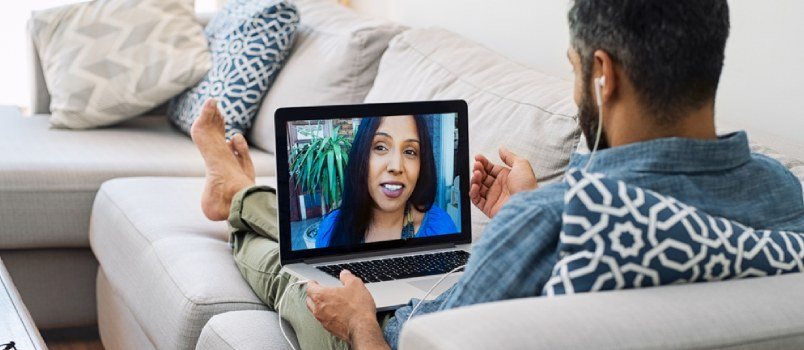 Man And Women Communicate Through Video Chat On Laptop