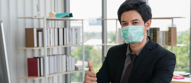 Businessman Wearing Medical Mask During Working In Office