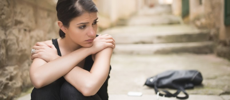 Woman Sitting Alone On The Stairs With Sad Face
