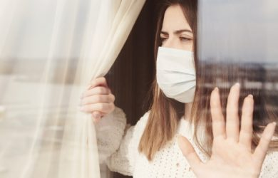 Young Woman In Medical Mask Stay Isolation At Home For Self Quarantine