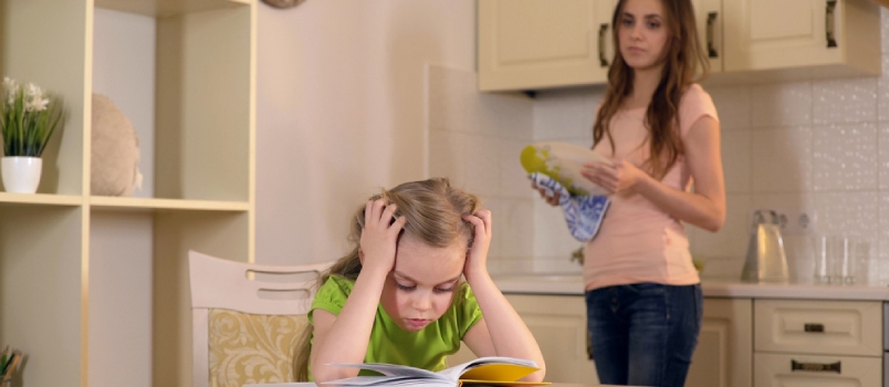Strict Mother Criticizing Daughter For Mistakes In Homework