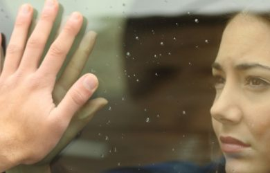 Couple Saying Goodbye Before Car Travel Holding Hands Through The Window