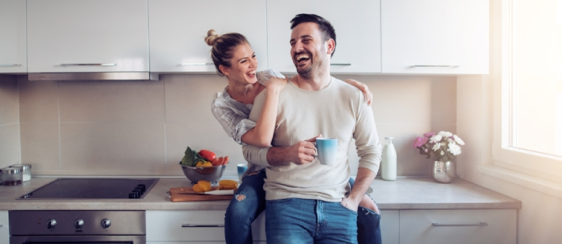 Romantic Young Couple Cooking Together In The Kitchen,having A Great Time Together