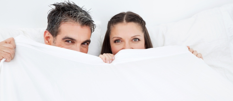 Postpartum Couple Under White Bedsheet
