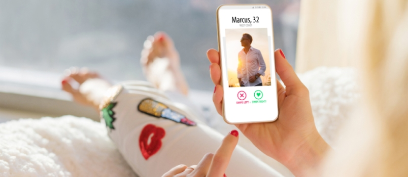 Woman Using Dating App On Mobile Phone