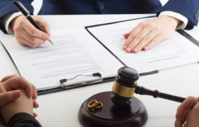 Hands Of Wife, Husband Signing Decree Of Divorce, Dissolution