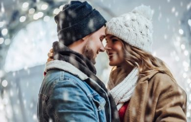Young Romantic Couple Is Having Fun Outdoors In Winter Before Christmas Spending Time Together