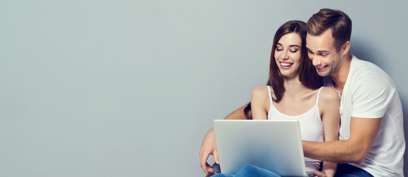 Wonderfull Couple Using Laptop Smile Face With Grey Chillout Background