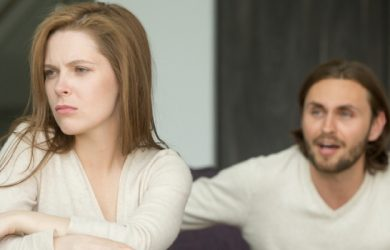 Offended Affronted Woman Ignoring Angry Man Sitting Her Back To Jealous Husband Shouting At Frustrated Wife