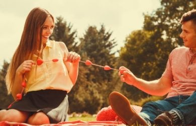 Enamoured Couple In Park. Girl And Boy In Park On Picnic, Love Romance Concept