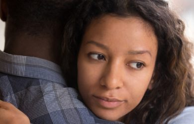 Pensive Young Mixed Race Girlfriend Think Of Something Hugging Boyfriend Making Peace After Fight