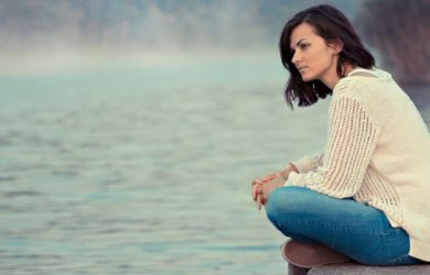Upset Lady Sitting By The Lake Thinking Something Deeply And Looking Away