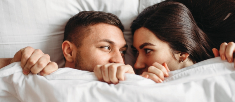 Couple Having Romance On Bed In The White Bedsheet
