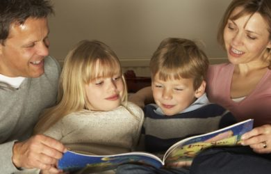 Happy Family Together At Home Children Are Studying Their Book