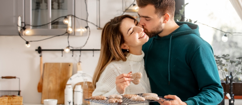 Young Happy Love Desired Couple Kissing In The Kitchen And Smiling In Love