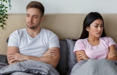 Unhappy Couple After Quarrel Lying In Bed Offended And Uninterested In Sexual Life At Home