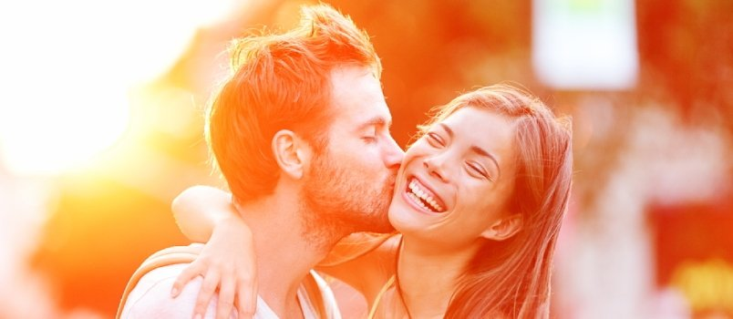 Couple Kissing Happiness Fun. Interracial Young Couple Embracing Laughing On Date