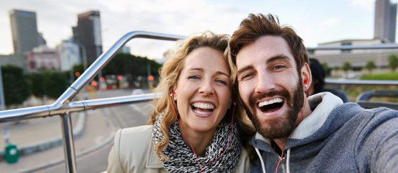 American Beautiful Couple Loudly Laughing Top On The Bus Floor While Exploring City