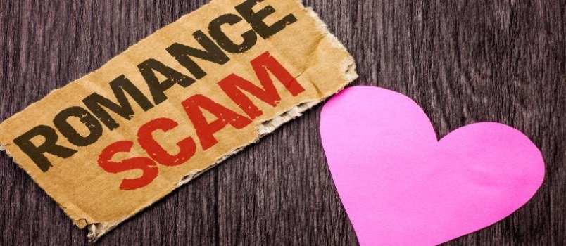 Heart Shape Paper With Sign of Romance Scam