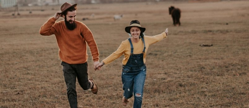 Man Holding Woman Hand And Running In The Ground Express Happiness Freedom