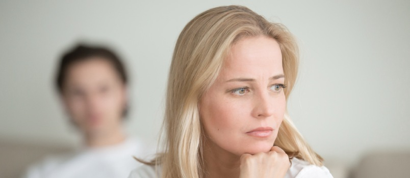 Close Upset Women Looking Away While Blurred Men Back To Women On Bed Quarrel Concept