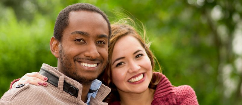 American Lady And African Men In The Park With Wearing Winter Dress Smiling Happily In Love Concept