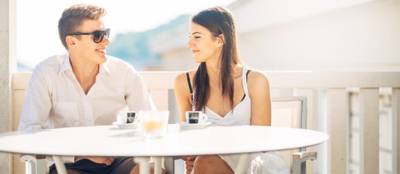 Attractive Couple Having First Date.blind Date.coffee With A Friend.smiling Happy People Having A Coffee,dating