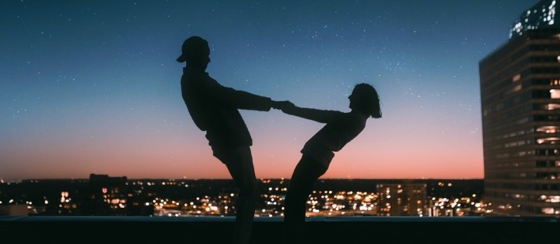 Couple Holding Hand Together With Beautiful Evening