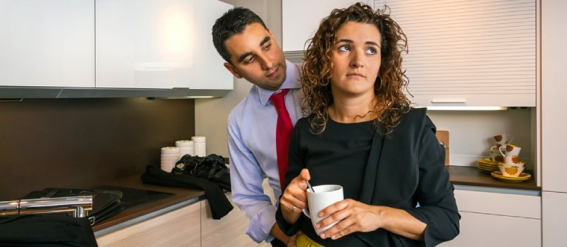 Businessman Embracing To Offended Woman At Home