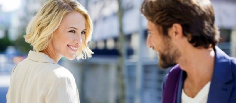 Couple Meeting First Time On The Street Looking Each Other And Smiling Together