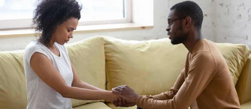 Loving African American Husband Hold Beloved Wife Hands Caressing Make Peace After Family Fight Or Misunderstanding