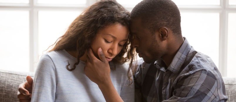 Loving African American Husband Touching Wife Face With Tender