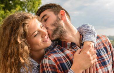 Man Kissing A Beautiful Woman With Wonderful Nature