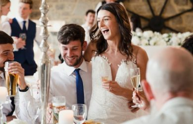Newly Wed Couple Are Socialising With Guests At Their Wedding Meal
