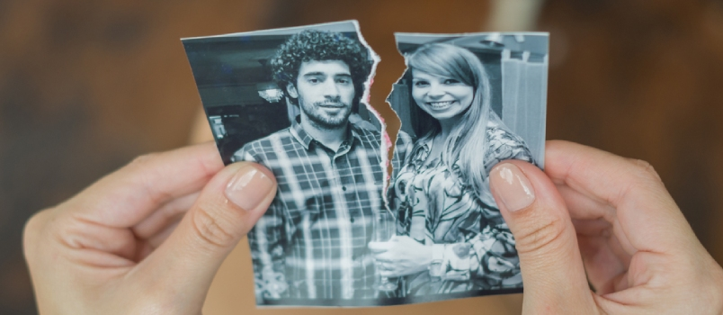 Great Concept Of Divorce, Betrayal, Separation, Woman Hand Ripping Photo Of The Couple