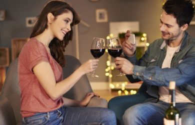 Wonderful Couple Enjoying Dinner With Red Wine At Home