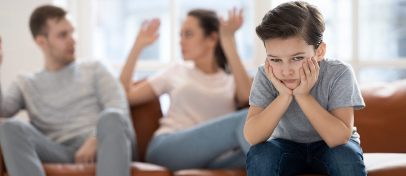 Frustrated Little School Boy Feeling Depressed While Angry Parents Fighting At Home