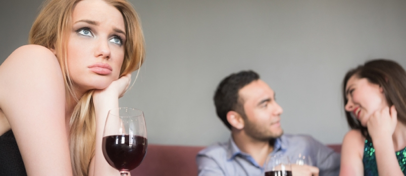 Blonde Woman Feeling Upset Of Couple Flirting Beside Her In A Bar